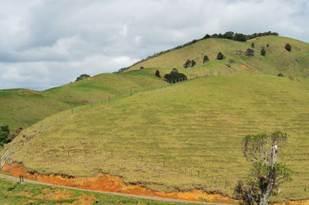 land slide: Erosion – the result of extensive deforestation to create more space for farming in the areas with rugged topography and a lot of rainfall.