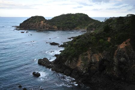 areas: Coast of various shapes with beaches cliffs and rocky areas around Matapouri in New Zealand.