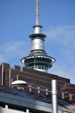hindrance: Sky Tower top hiding behind other tall buildings in Auckland CBD.
