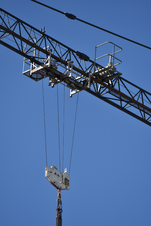 slew: Detail view of tower crane at construction site.