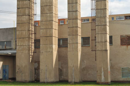 tall chimney: Concrete chimneys of heating plant in urban area.