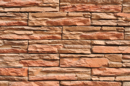 Wall made of layers of red slate.