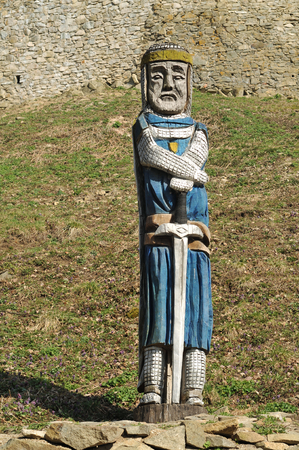 Knight statue under Saris castle walls.