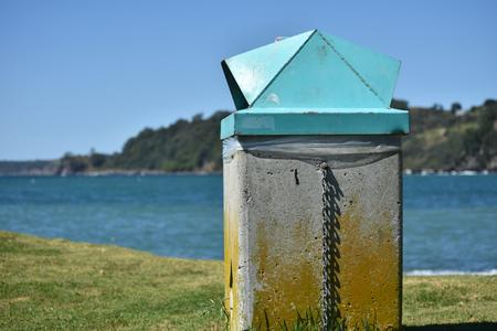 oceanside: A public rubbish bin on the beach.