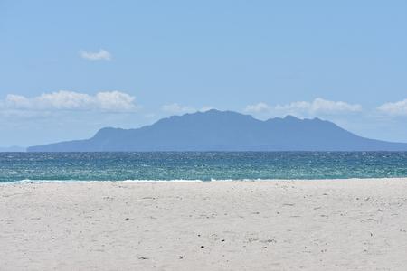 barrier island: A view of Little Barrier Island from Pakiri Beach.
