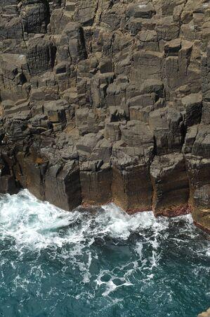 kiama: Waves crashing on basalt cliffs. Stock Photo