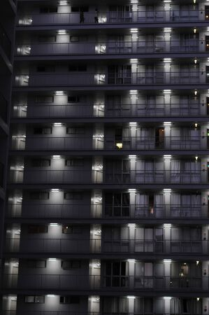 Outside of an apartment building at night