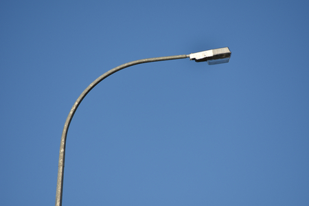 Streetlight during the day in landscape format.
