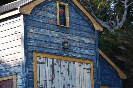 Old boat shed with peeling paint. Stock Photo
