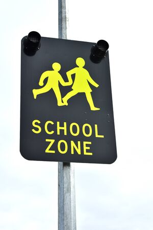 metal pole: School zone street sign on metal pole. Stock Photo