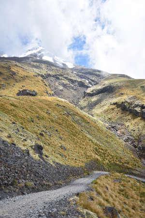 egmont: Gravel road up Mt Egmont in Taranaki. Stock Photo