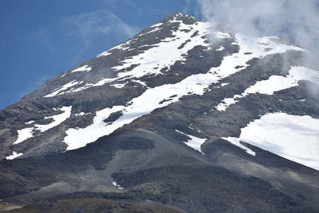 egmont: Mt Egmont in Taranaki showing sharp contrast between white patches of snow and dark volcanic rock.