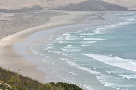 reinga: Flat sandy beaches of most northern part of New Zealand at Cape Reinga.