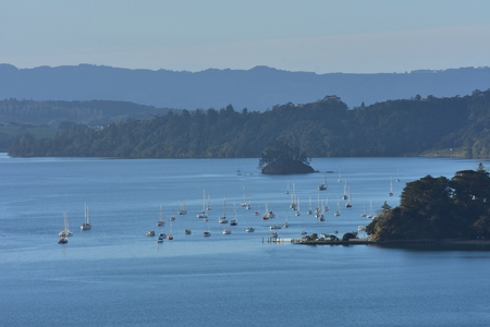 Scenery from inside Mahurangi Harbour with moored boats  on calm day. Stock Photo