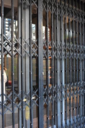 shop window: Metal security screen protecting shop window and door. Stock Photo