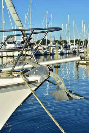 Sailing ship bow with stainless steel railing and anchor.