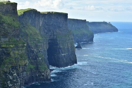 Cliffs of Moher in morning when rocky cliffs are in deep shadow. Stock Photo