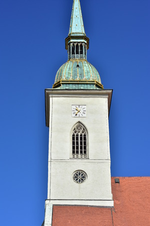 Gothic spire of St Martin cathedral in Bratislava dominates skyline of Old Town.