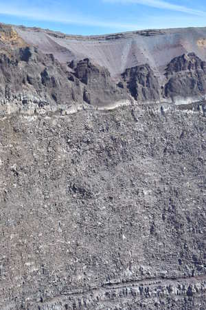 Vertical view of edge and internal walls of Vesuvius volcano near Naples in Italy.