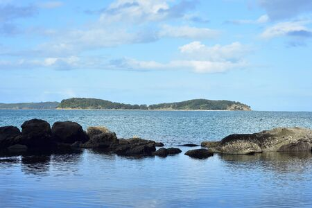 View of tiny Saddle Island from inside of Mahurangi Harbour near Auckland in New Zealand.