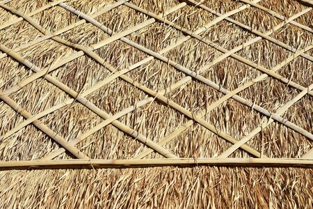 Detail of traditional Balinese rural thatched roof made of straw and bamboo sticks.