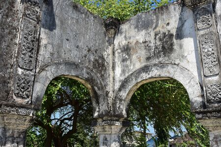 Preserved stone ruin of building on premises of Ujung Water Palace in Bali.