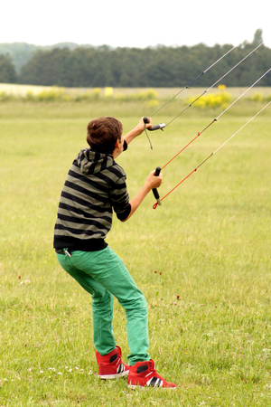 kiting: land kiting teenager Stock Photo