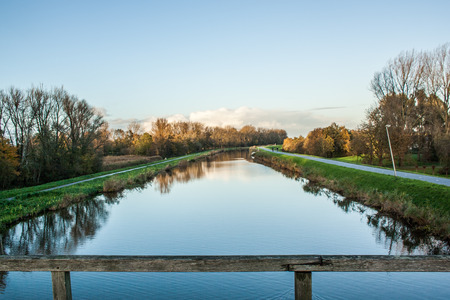 Bridge over canal embanking dutch polder Stok Fotoğraf