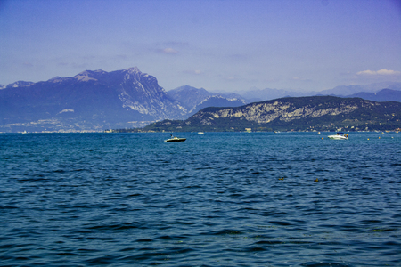 Nice view of Lake Garda with the small boats Stok Fotoğraf