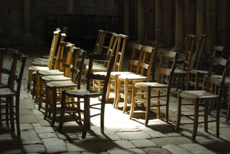 Chairs in ray of sun photo