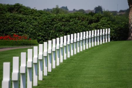 mortality: margraten cemetery row headstones sunny day