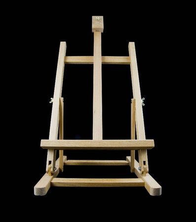 Empty easel on black background for displaying artwork