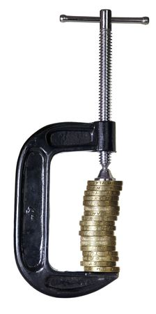G-clamp holding a stack of British pound coins