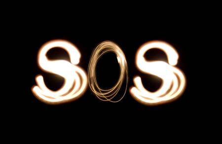 Light painting photograph of the distress signal SOS