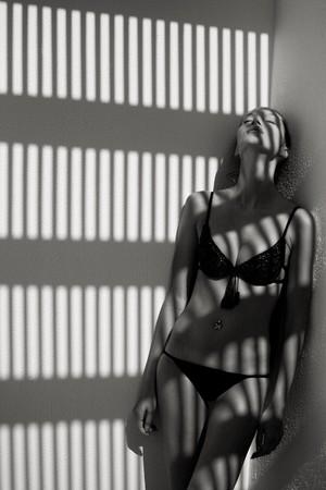 Beatiful woman in the shadow photo
