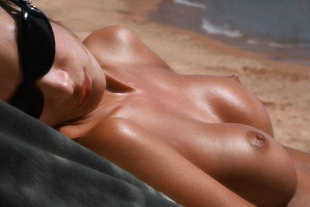 beach breast: Beautiful woman sunbathing on the beach Stock Photo