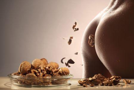 Fitness body cracking walnuts apart Stock Photo - 4682116