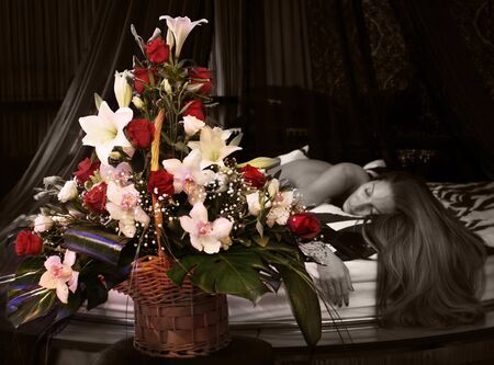 Beautiful bouquet, woman in bed on the background photo