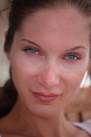 Face of beautiful young woman with freckles Stock Photo - 4717839
