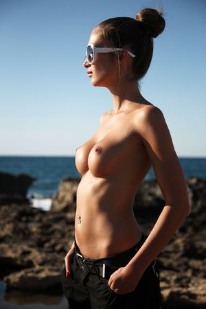 woman standing on the beach photo
