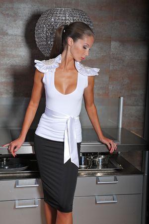 Woman posing on a kitchen Stock Photo - 4795719