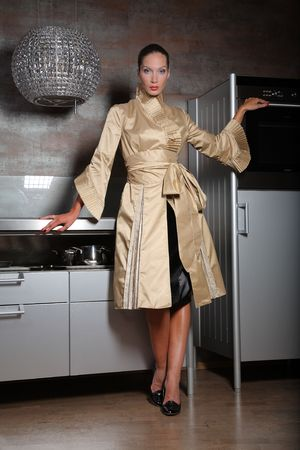 Woman posing on a new kitchen photo