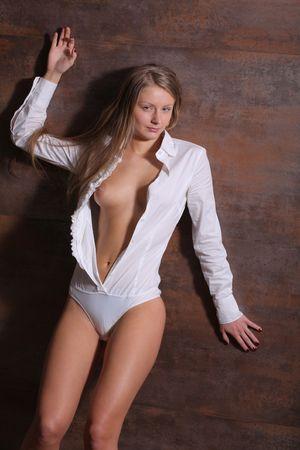 unbutton: Woman in white unbuttoned body Stock Photo
