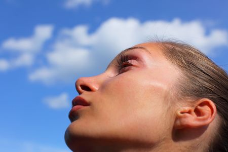 Beautiful woman looking up in the sky photo
