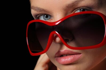 red head woman: Closeup of young woman in sunglasses Stock Photo
