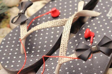 leisure wear: rubber flip-flops with earphone