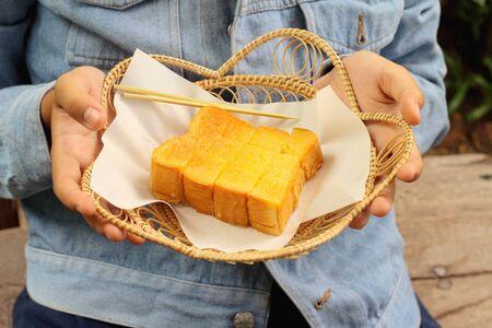 bread and butter: man holding bake bread, butter - a sweet dessert.