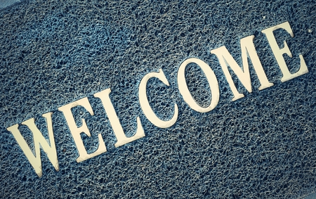 carpet clean: The blue doormat with a welcome text