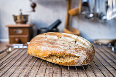 freshly baked sourdough bread removed from the oven