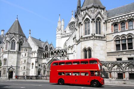 double decker: London, England, June 2007 -  old double decker bus and court building